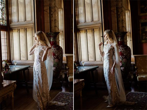bride fixing her veil in drawing room