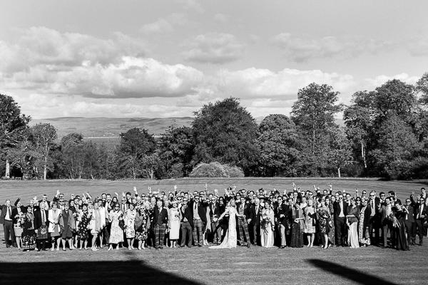 group photo on lawn at scottish wedding