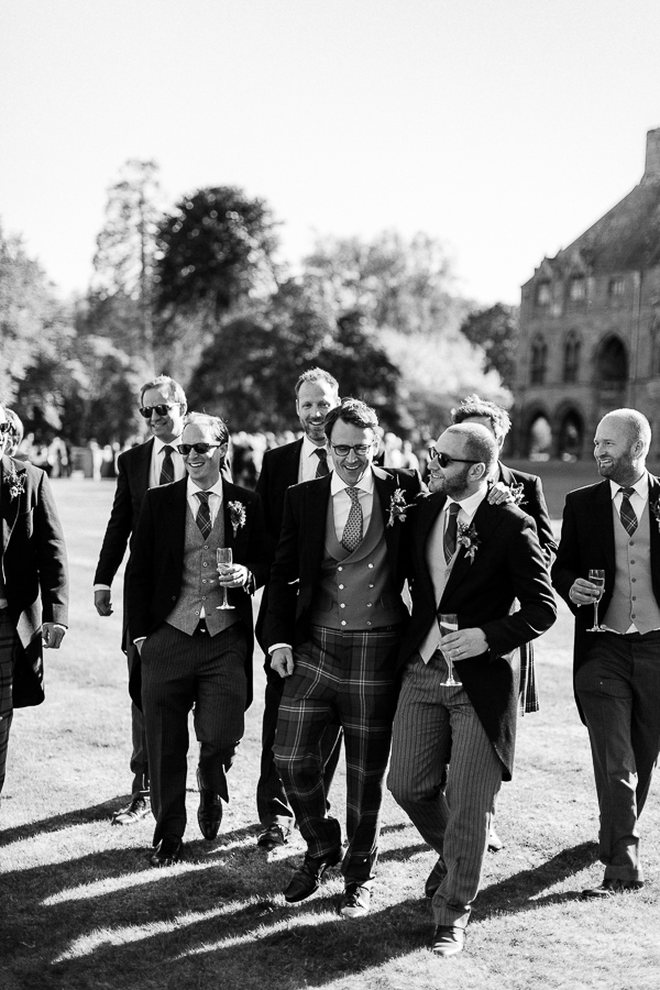 summer wedding groomnmen walking