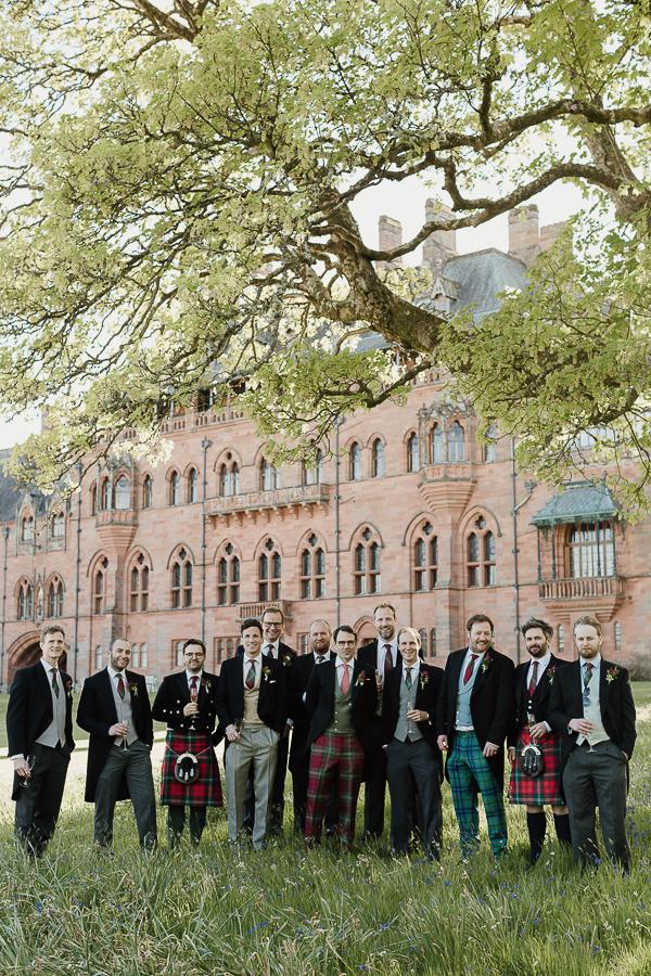groomsmen posing together in tartan