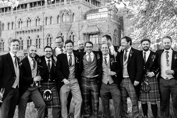 groom with friends at wedding venue