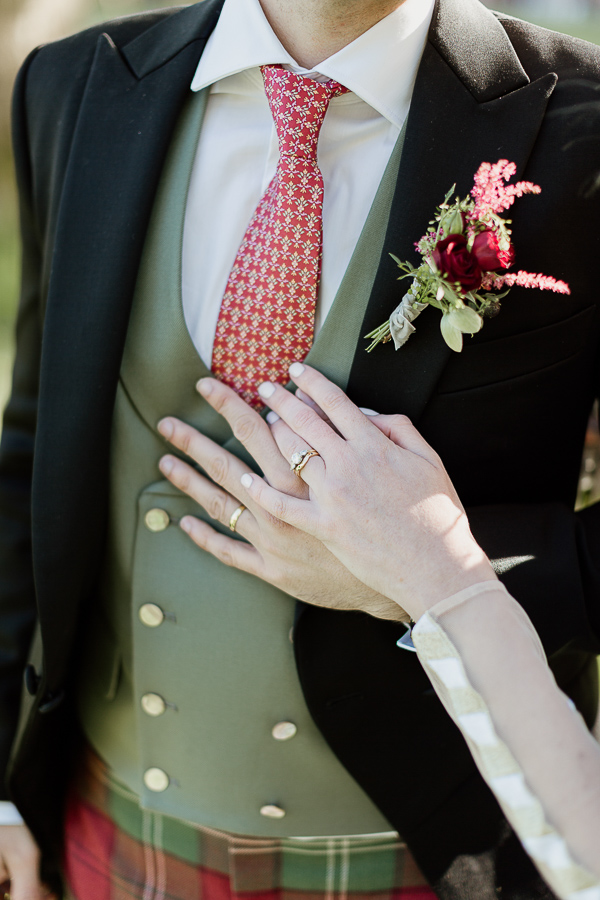 wedding rings withhands and tartan in scotland
