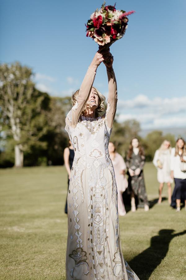 bride tossing bouquet at mount stuart