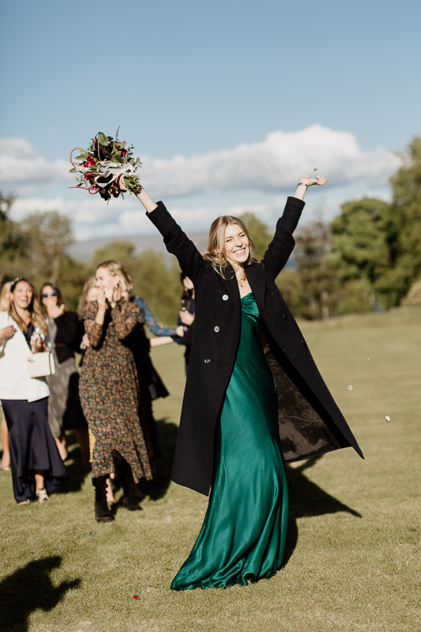 bridesmate catches flowers after tossing