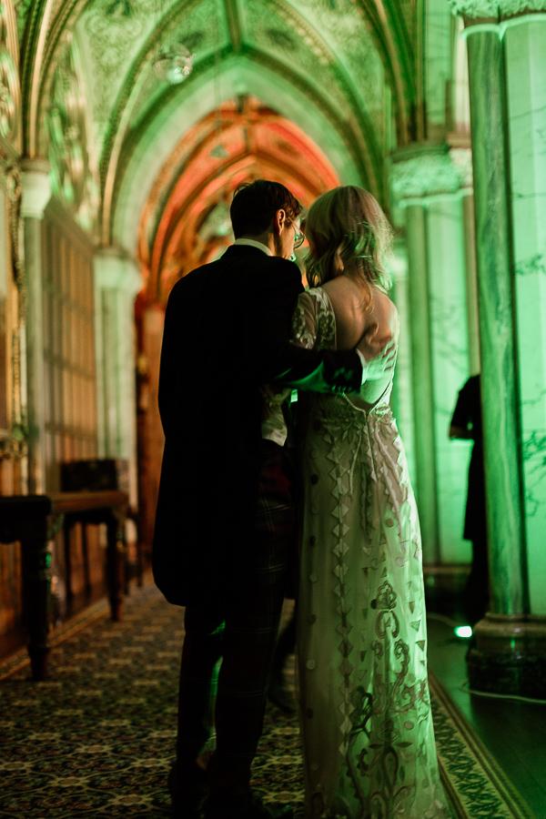newlyweds embraced at wedding