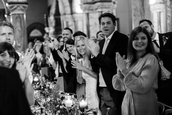 wedding guests clapping