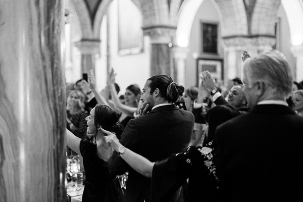guests clapping and cheering seeing bride and groom