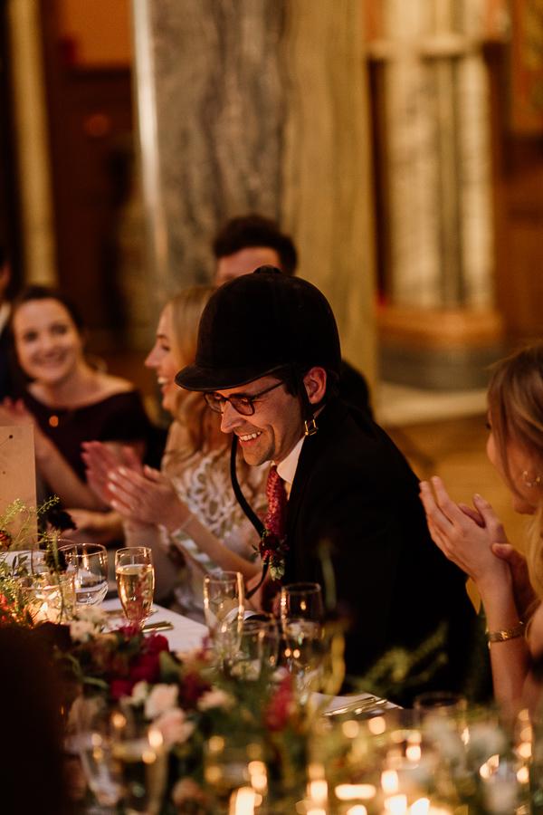 groom is wearing jockey hat at speeches