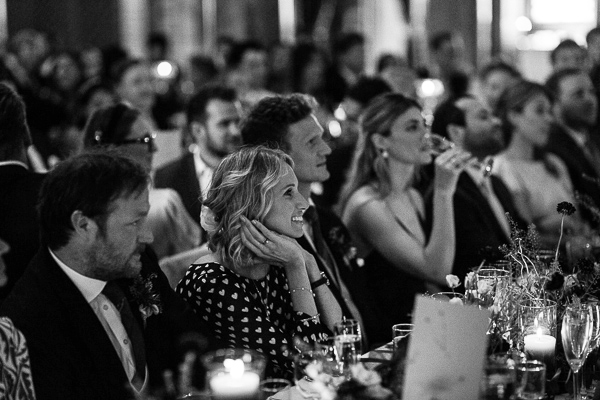 wedding guests looking at speakers during speeches