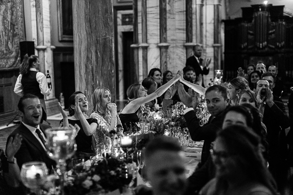 guests cheering during wedding speeches