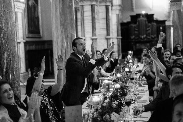 wedding guests clapping at reception