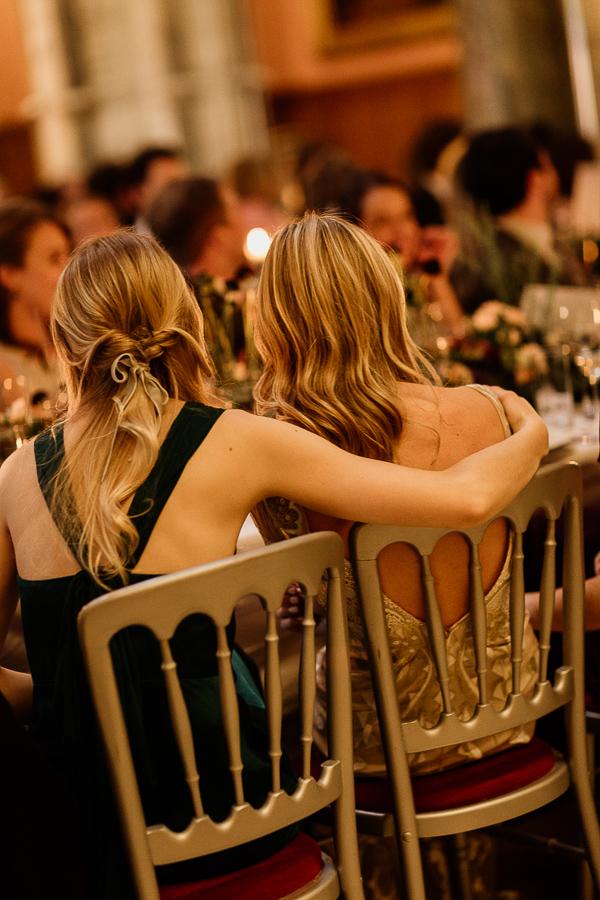 bride and bridemsate hugging at speeches