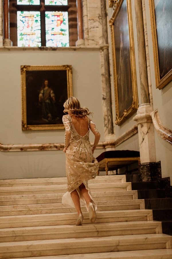 bride running up the stairs to change