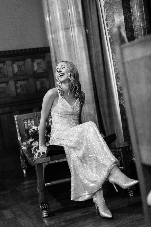 bride laughing sitting in a choroscope room