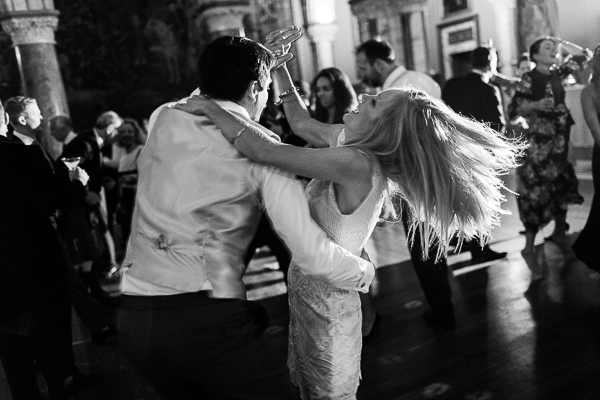 a couple dancing on a wedding reception