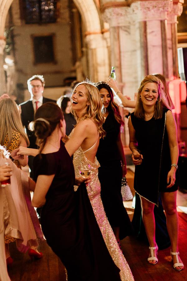 girls smiling and dancing at wedding