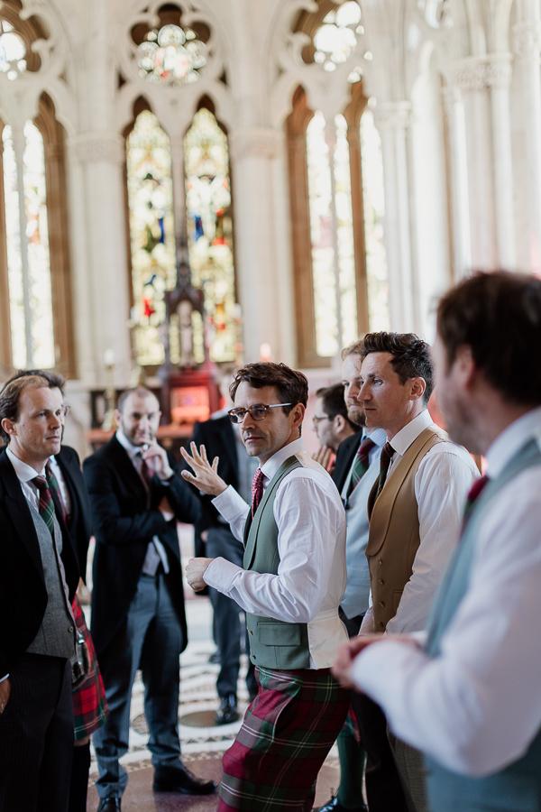 groom with groomsmen at chapel