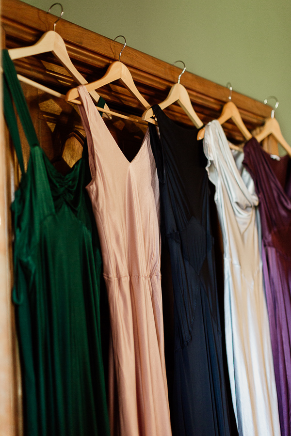 bridesmates dresses multicolour hanging on door