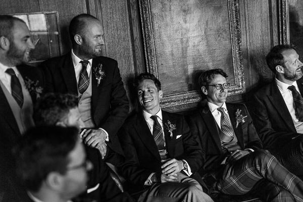 groomsmen laughing waiting