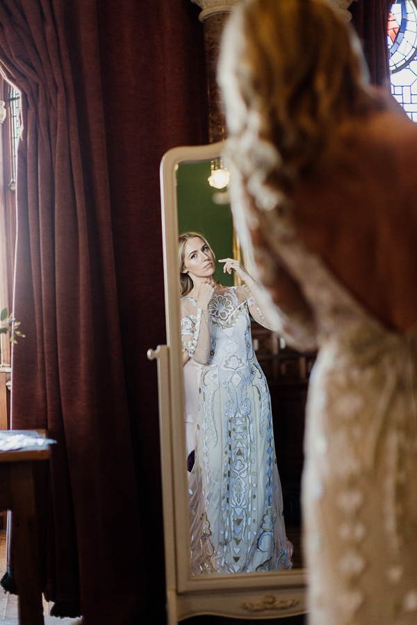 bride getting ready at mount stuart looking in the mirror