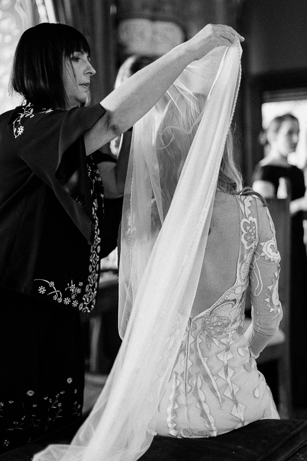 mother of the bride putting veil during preparations