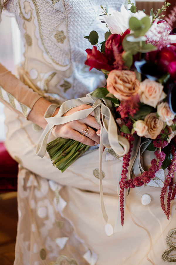egagement ring with flowers on bride