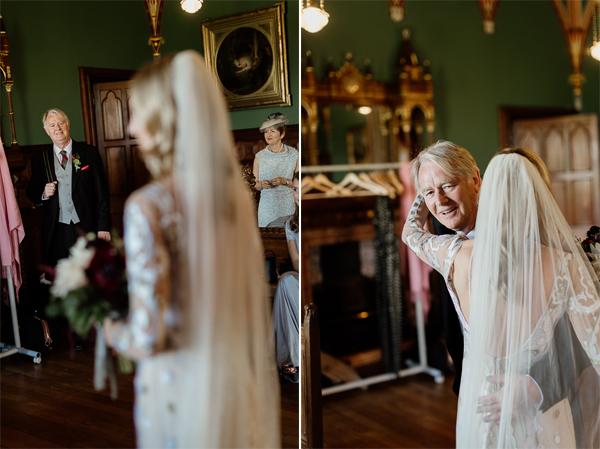 dad seeing daughter in wedding dress huging