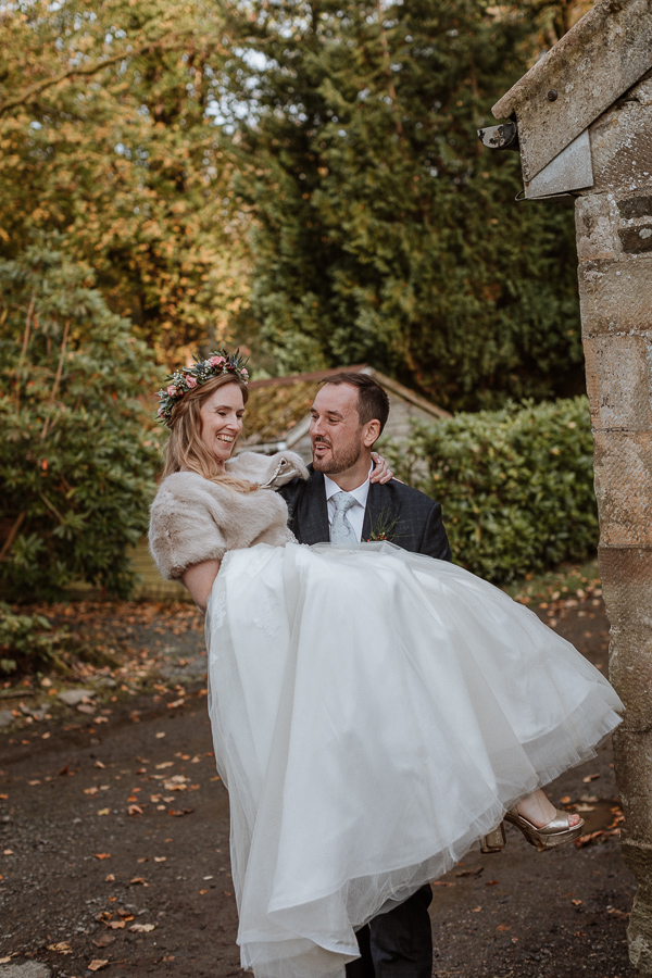 groom lifting up his bride at Glenapp Castle Scottish 5 star venue