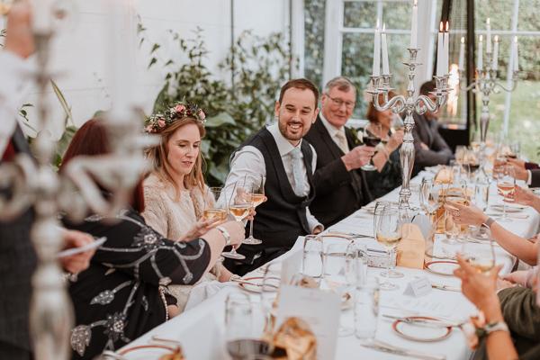 newlyweds raising toast wedding photographers ayshire