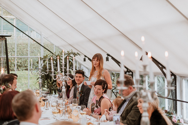 Sister speeking at the wedding inside a Glenapp Greenhouse