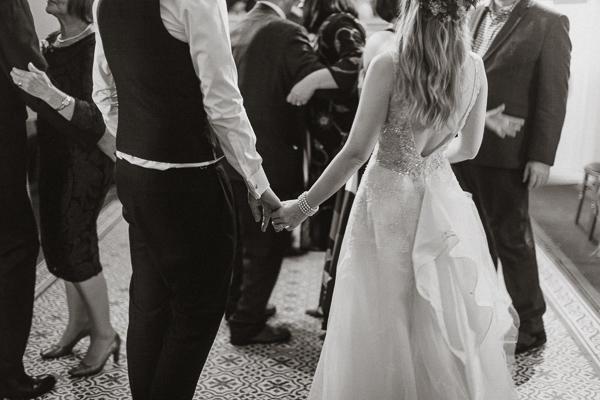 holding hands at the evenig reception in Glenapp Castle Estate