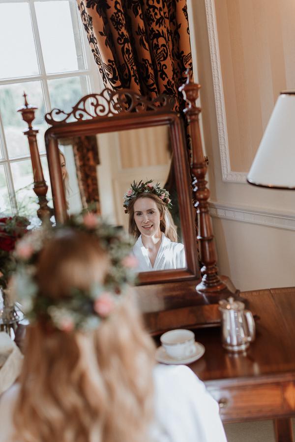 Bride in the mirror at Glenapp Castle Scotland