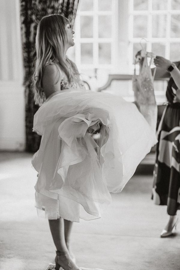 bridesmaid holding wedding dress Glenapp wedding venue