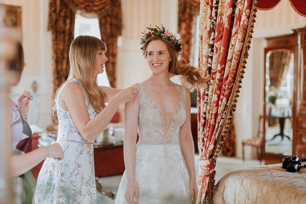 sister helping with a necklace at Glenapp Castle Wedding Photos