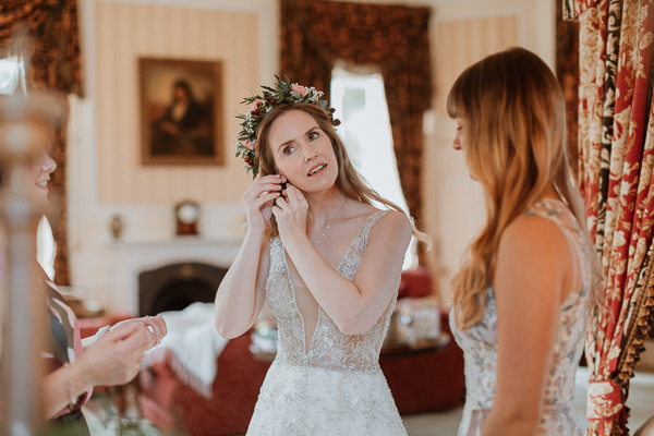 bride trying her earings at Glenapp Castle Ayrshire