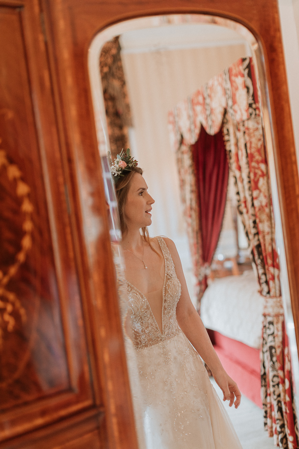 beautiful bride in the mirror at the wedding in Glenapp Castle