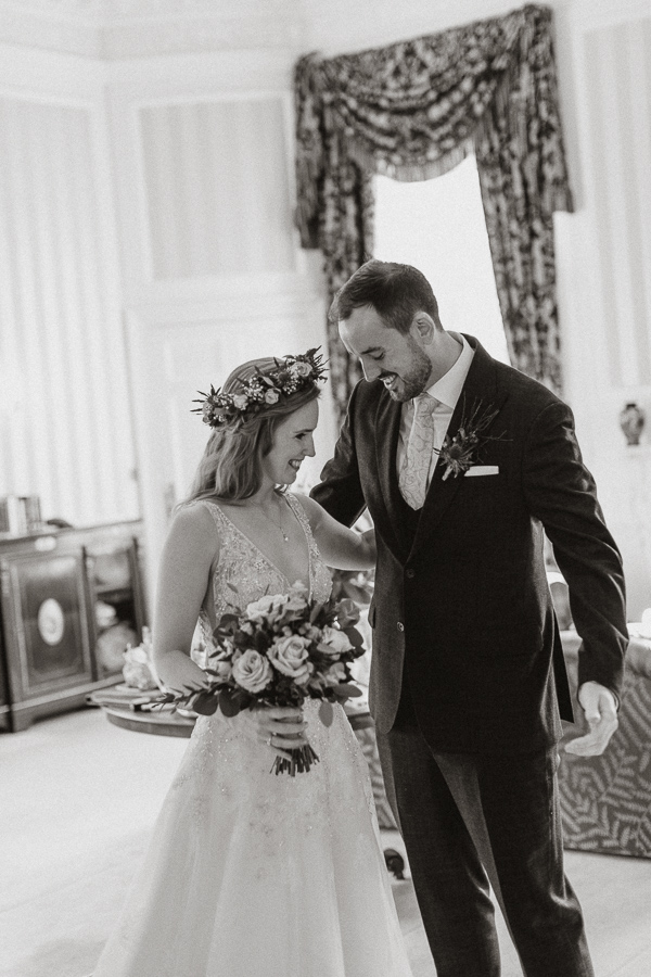 bride and groom happy at the frist glance at Glenapp Wedding Venue