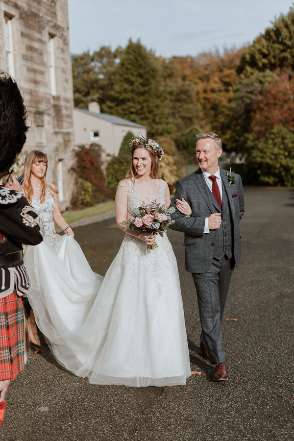 birde and her father walking do the aisle at glenapp castle