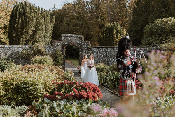 bride approaches a green house at Glenapp Castle Scotland