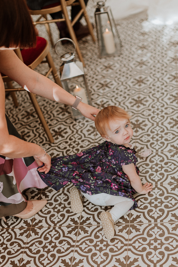 a little girl crawling during the ceremony at Glenapp Castle SCotland