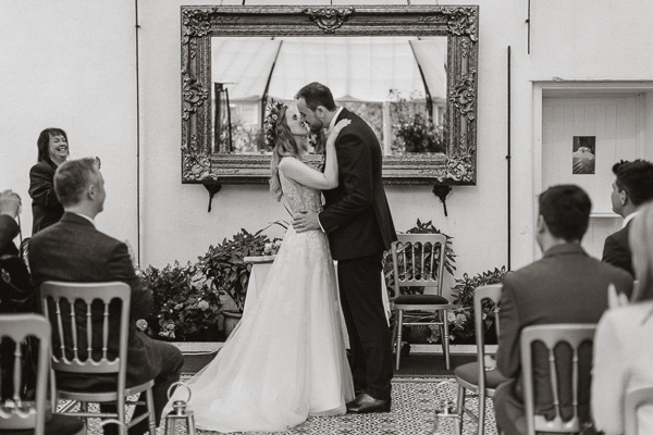 first kiss during a wedding at Glenapp Greenhouse