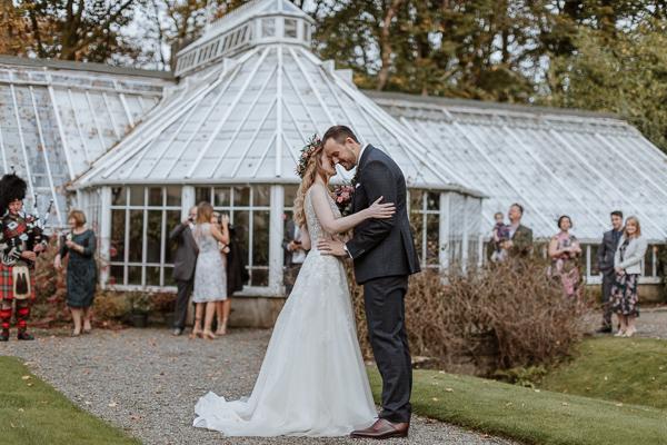 Bride and Groom freshly married outside of Greenhouse in Glenapp Estate