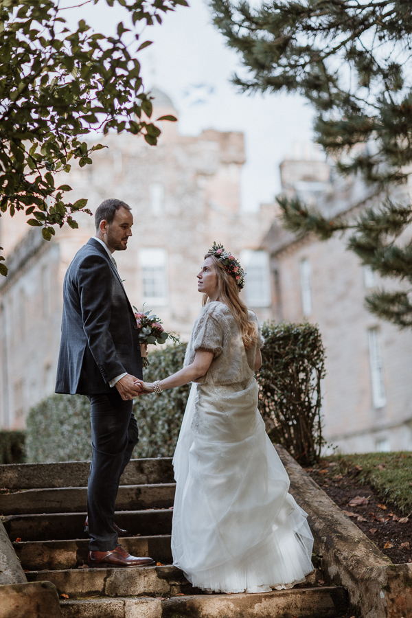 bride and groomn stopped on the steps at Glenapp Castle Ayrshire