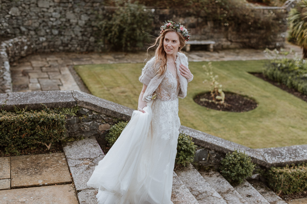 bride walkign down the steps at wedding photoshoot at Glenapp estate