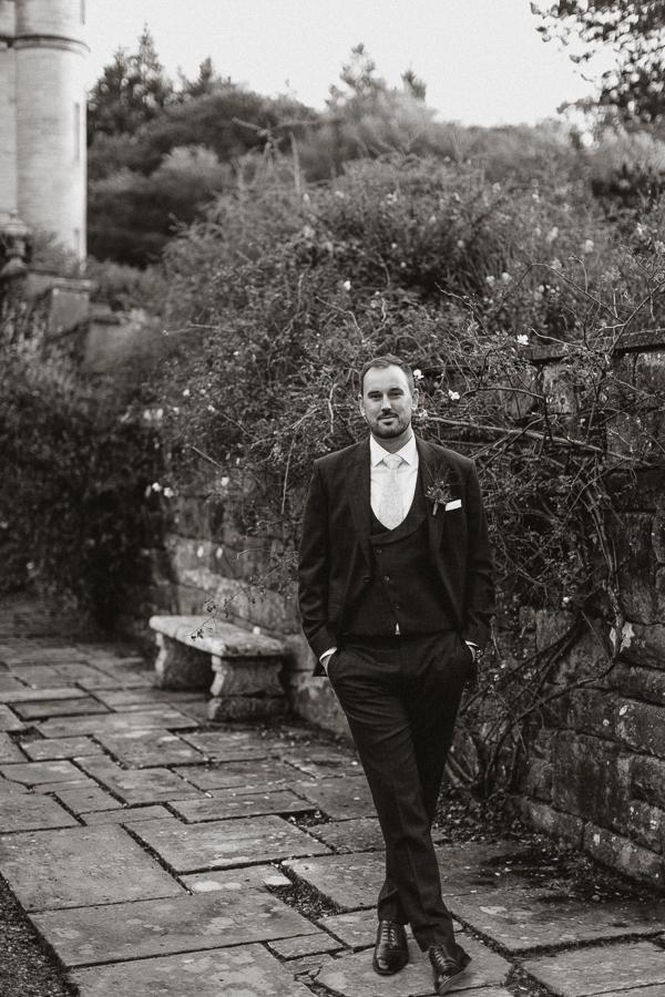 groom posing in the Glenapp Estate gardens