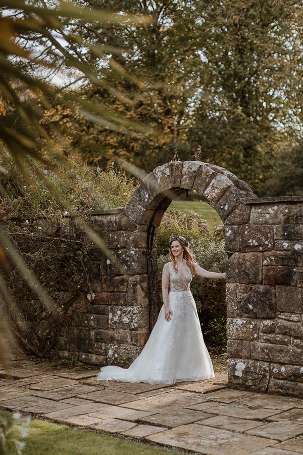 bride loooking towards the groom in the gardens of Glenapp Castle Estate