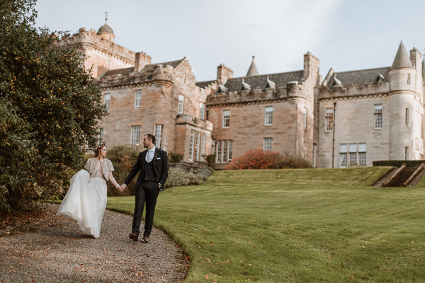 bride and groom in the front of Glenapp Castle Ayshire