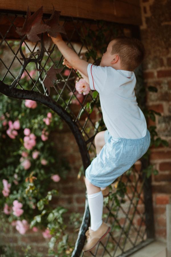 page boy climbing before wedding