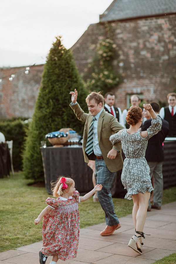 groom dancing with her sister outdoors at dumfries house