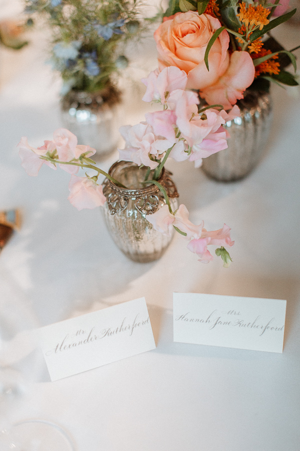 flowers and name cards at dumfries house wedding